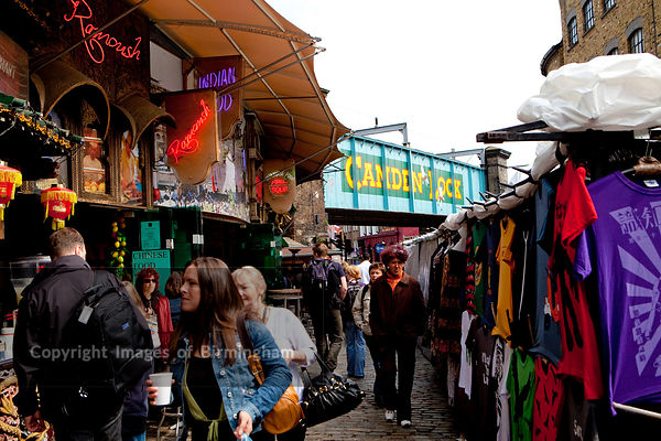 Camden Lock Market. Clothes on stalls and cafes.