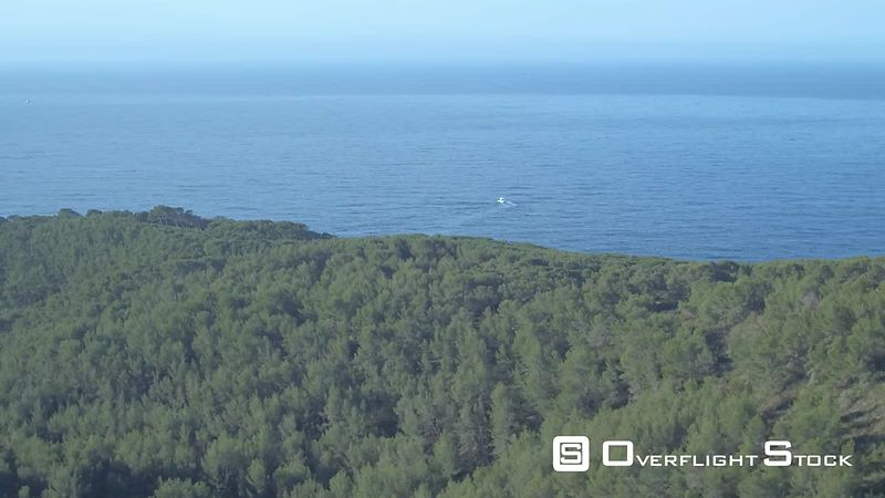 Aerial view of a pine trees forest and the Mediterranean Sea, filmed by drone, Bandol, France