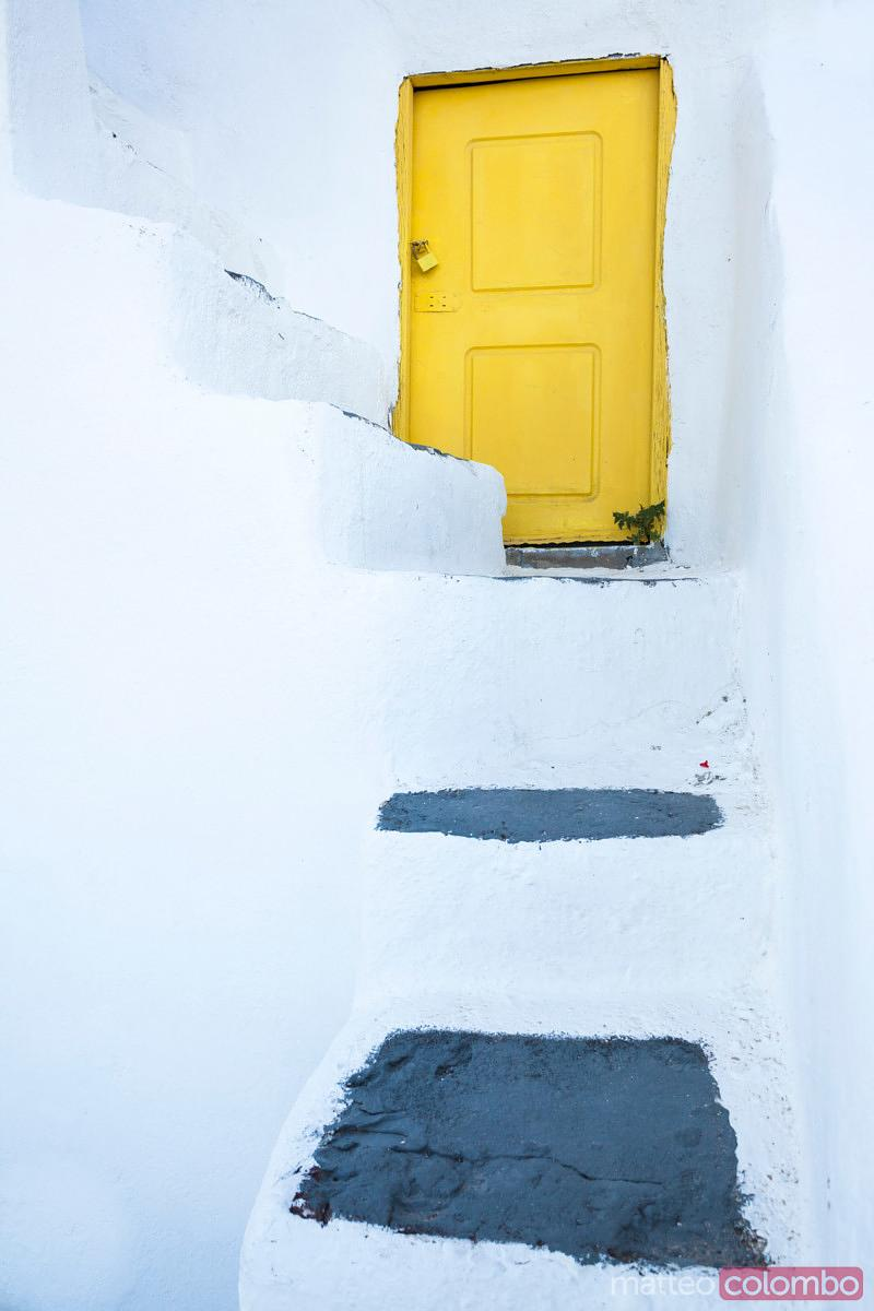 Small yellow door and steps