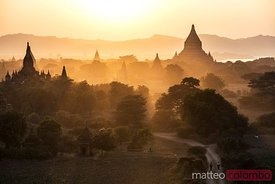 Sunset over dusty plains and temples of Bagan, Myanmar