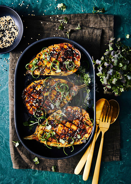 Miso glazed eggplant grilled with asian shallots and sesame seeds.