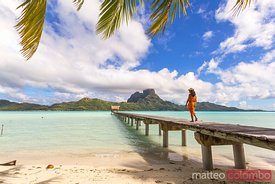 Local tahitian woman on jetty, Bora Bora, French Polynesia