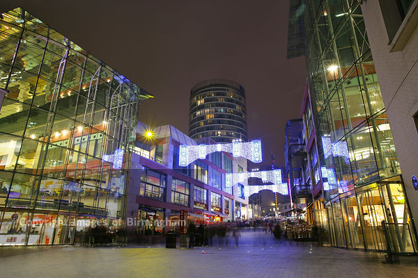 Christmas in Birmingham, England. The Bullring Shopping Centre and Rotunda with Christmas lights.