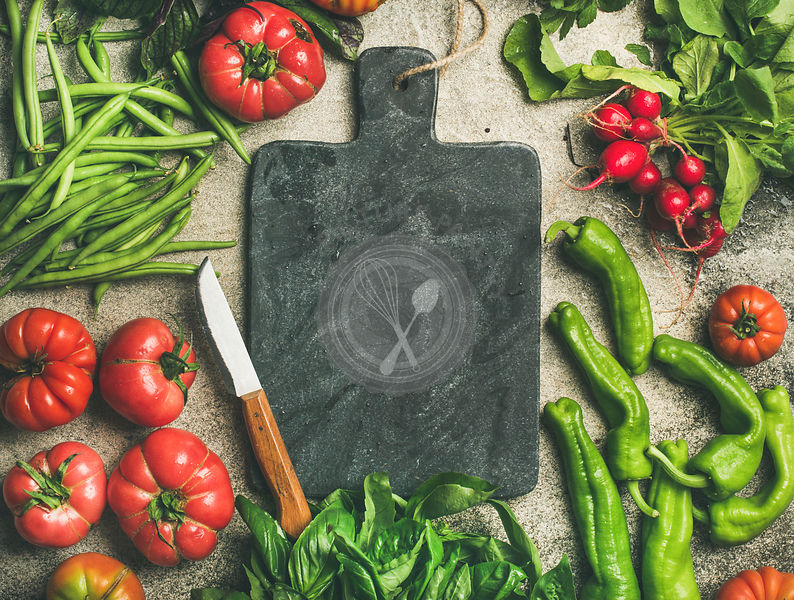 Healthy food cooking background with seasonal vegetables and greens