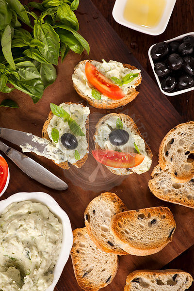 Crostini with mozzarella and fresh basil and olives