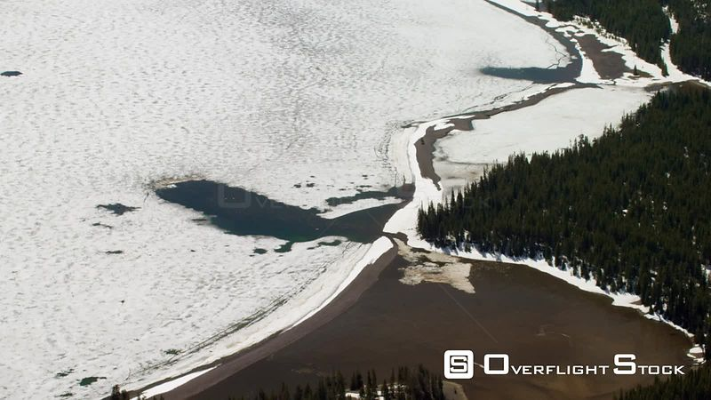 The paritally frozen shoreline of Yellowstone Lake in Yellowstone National Park