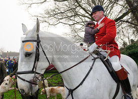 Huntsman Andrew Osborne MFH gives a young supporter a ride - The Cottesmore Hunt's Boxing Day meet 2013.