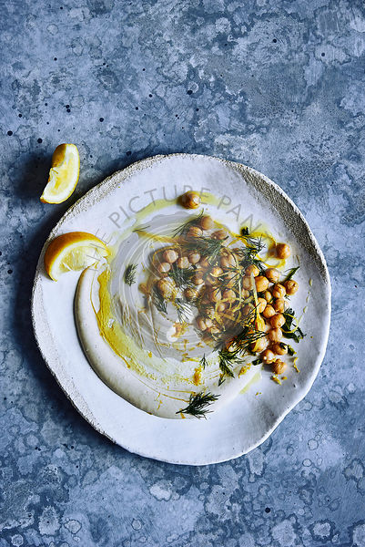 hommus dip with chickpeas, dill, lemon zest and a drizzle of olive oil.