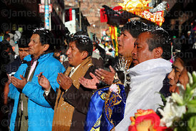 Hosting family (preste) during blessing ceremony at start of Gran Poder festival, La Paz, Bolivia