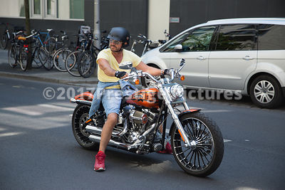 Motor Biker on a Harley Davidson bike on the streets of Berlin