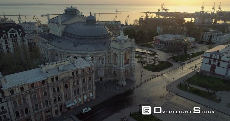 Aerial camera flies slowly towards the Odessa Opera Theatre at sunrise. Camera tracks the building Ukraine