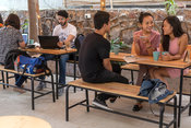 Customers sit and chat over coffee in the garden of Blue Tokai coffee in Champa Gali,