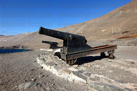 Cannons on cast iron wheeled carriage at a former Peruvian land battery , Pisagua , Region I , Chile
