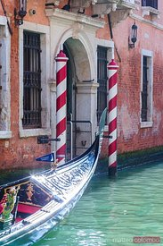 Italy, Veneto, Venice. View of a canal with gondola passing
