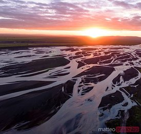 Aerial drone view of braided river at sunset, Iceland