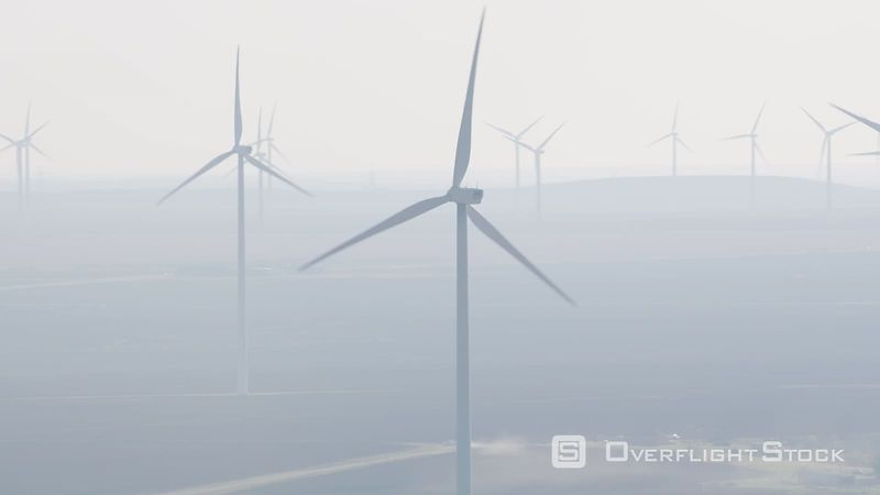 Aerial view of wind turbines in the fog