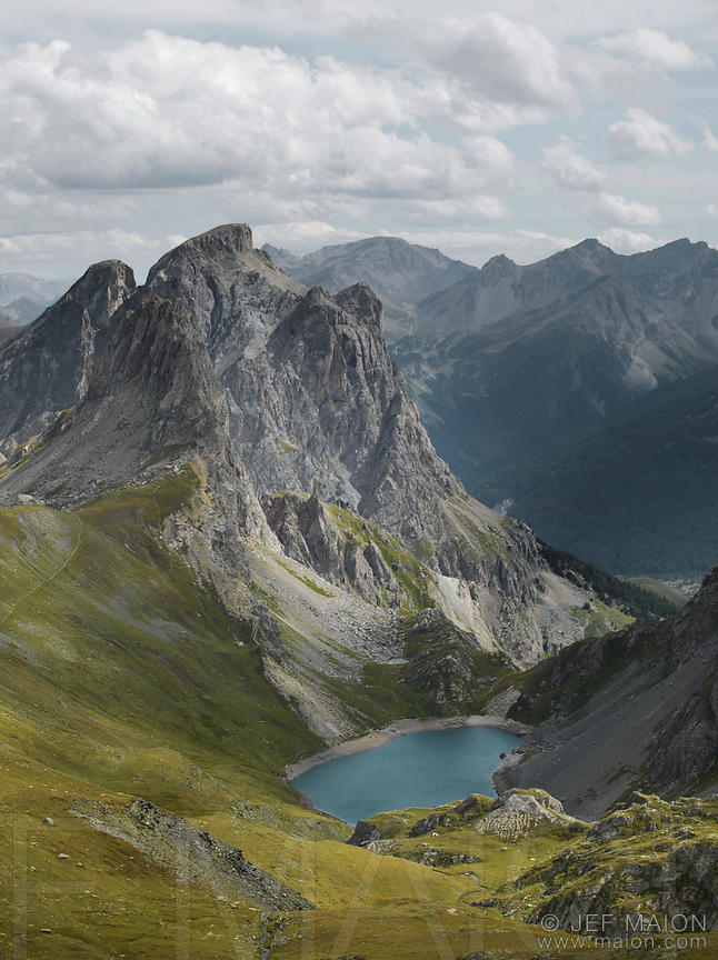 Rock peak and lake seen from above