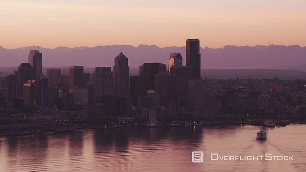 Seattle, Washington Aerial view of ferry and Seattle skyline at sunrise.  Shot with Cineflex and RED EpicW Helium.