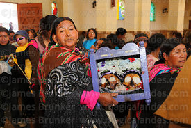 Aymara woman with her skulls in church during mass, Ñatitas festival, La Paz, Bolivia