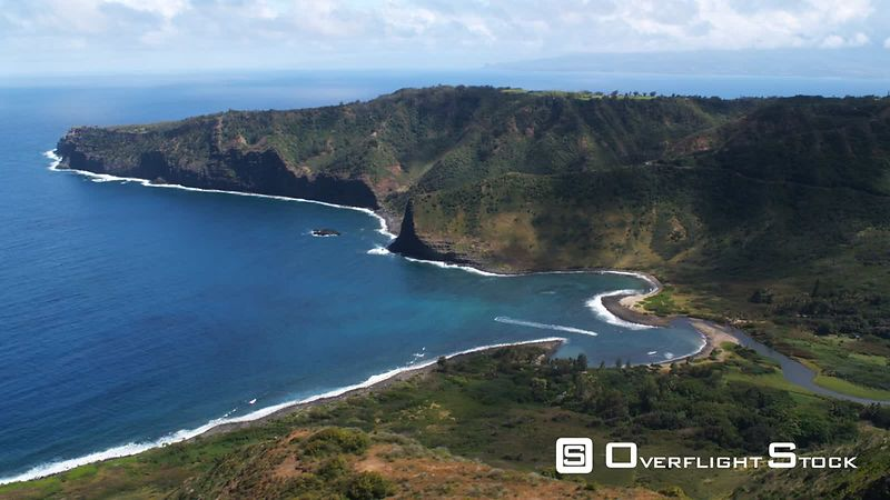 Over hilltop to orbit a cove on Molokai.