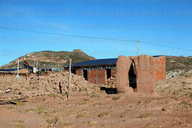 Adobe chulpa next to unfinished house on outskirts of Curahuara de Carangas, Oruro Department, Bolivia