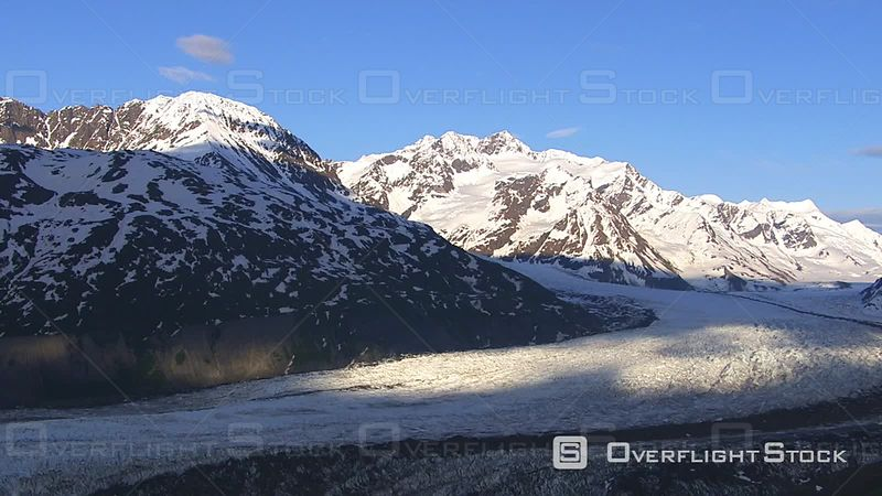 Aerial Footage of Glacier and Lake With Snowy Mountains, Alaska