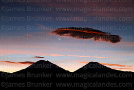 One day old new moon above Payachatas volcanos at sunset, Sajama National Park, Bolivia