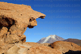 Eroded volcanic rock formation and Cerro Ollagüe volcano, Nor Lípez Province, Bolivia