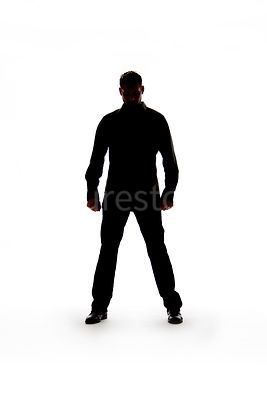 Silhouette of a man standing – shot from mid level.