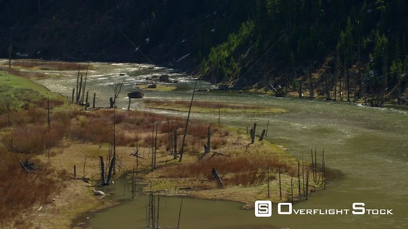 The Madison River flows through a steep valley between Hebgen Lake and Earthquake Lake near Yellowstone National Park