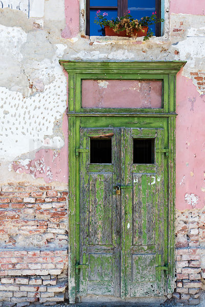 Green Door, Distressed Pink Wall and a Windowbox against a Blue Sky