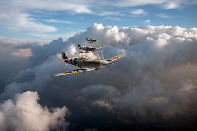 D-Day Spitfires among clouds