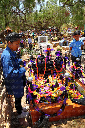Grave gecorated with ribbons, food and pasankalla in cemetery for Todos Santos festival, Sipe Sipe, Cochabamba Department, Bolivia