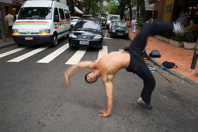Capoeiristas performing for money