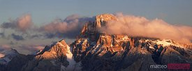 Mountain range at sunrise with clouds Dolomites Italy