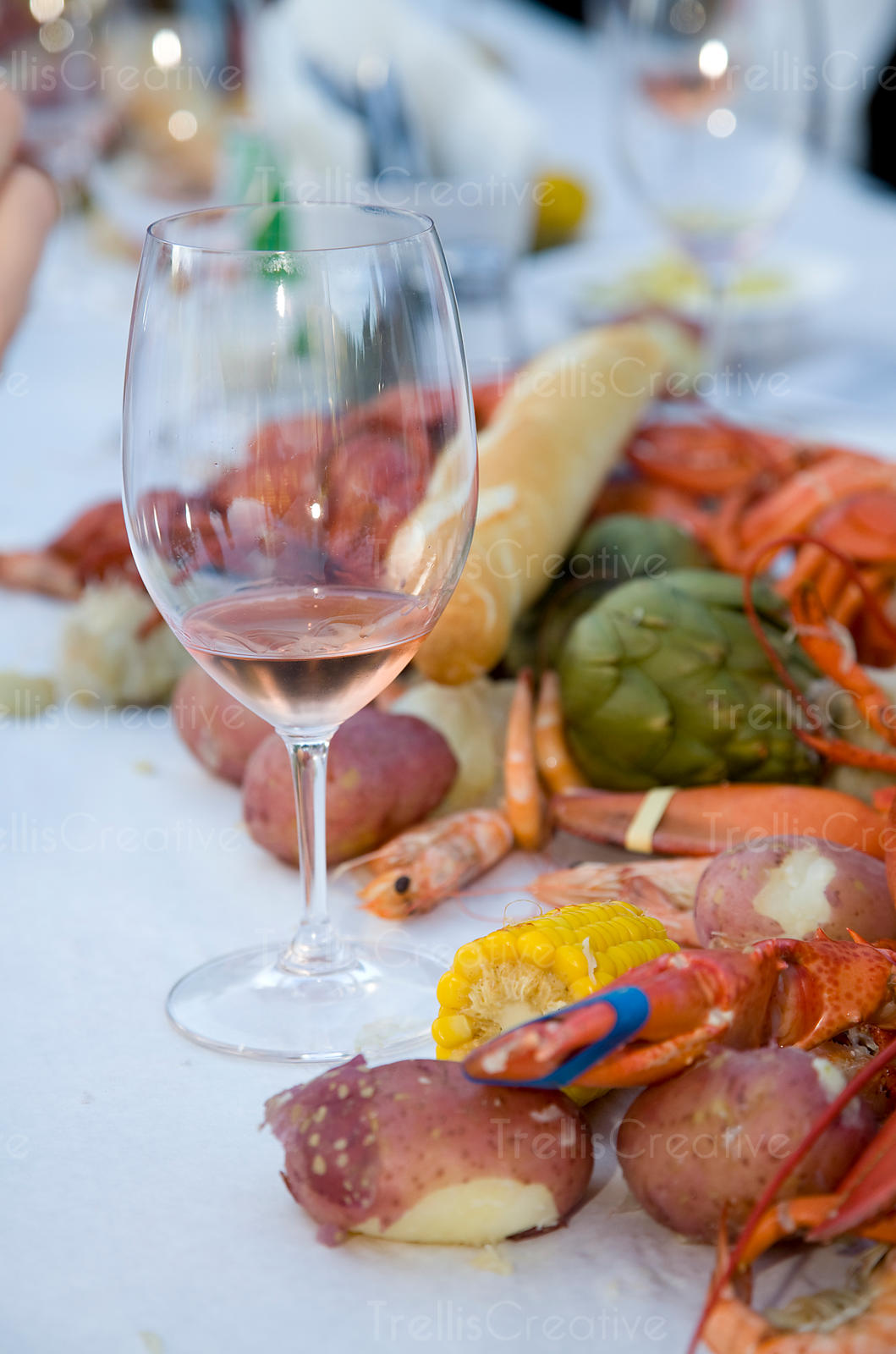 Chilled rose wine is paired with steamed lobster and summer vegetables