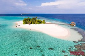 Aerial view of couple on a beach, Maldives