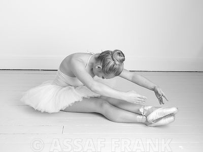 Young Ballerina sitting on floor