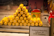 Corn on the Cob piled in a triangle shape on. a stall at the White Magic Christmas Market