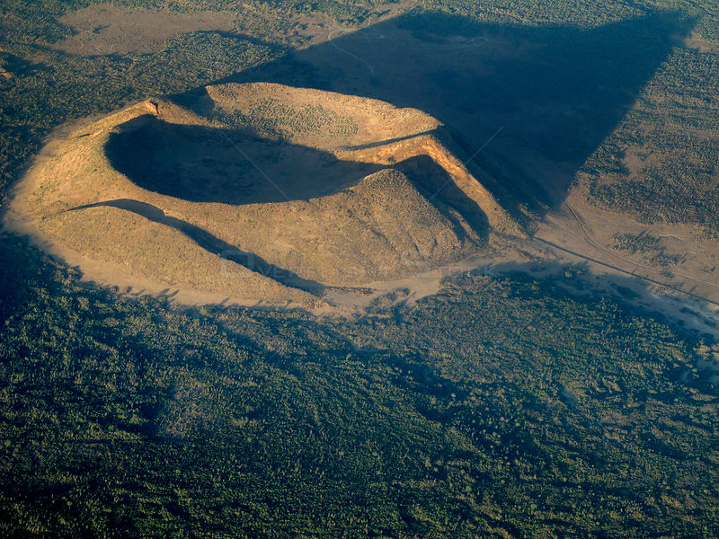 A small volcanic cone with crater, that has been split by two faults.Rift Valley, North west of Nairobi, Kenya, March 2012