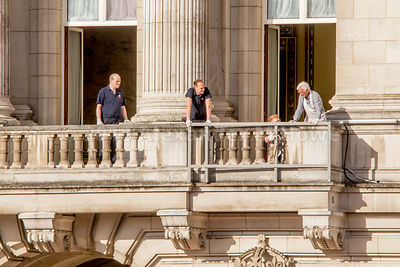 Workers preparing the Buckingham Palace balcony for the royal family's appearance