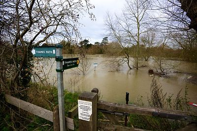 Footpath Sign Pointing out Across Floodwaters in Oxfordshire Village