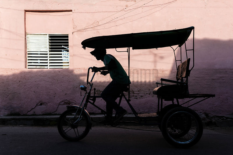 Sillhouette of Man Driving Bicitaxi