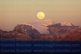 Full moon rising directly behind Mt Mururata (4 of a series of 4 images), Cordillera Real, Bolivia