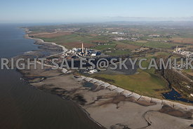 Aberthaw aerial photograph of the geological features and the beaches and erode volcanic rock shelving and the Aberthaw coal powered power station situated on the Welsh Coastline