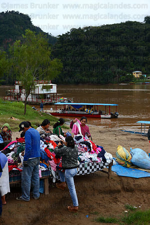 Second hand clothes market on shore of River Beni , Rurrenabaque , Bolivia