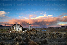 Rustic church near Lagunas and storm clouds at sunset, Sajama National Park, Bolivia