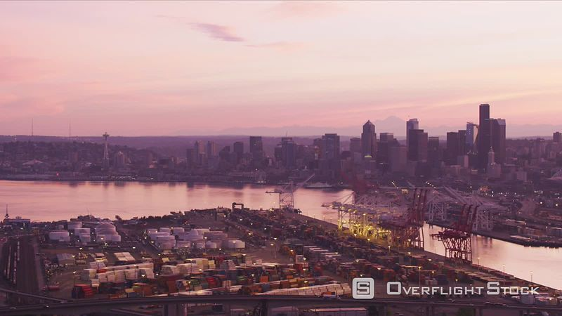 Seattle, Washington Aerial view of port with downtown Seattle in distance at sunrise.  Shot with Cineflex and RED EpicW Helium.