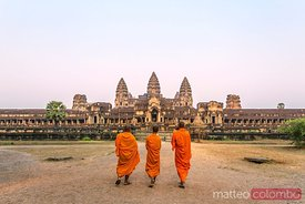 Three monks walking to Angkor Wat temples, Cambodia