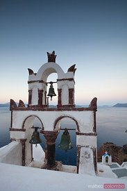Typical bell tower in Santorini, Greece, at sunrise